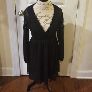 Sheer and lace black little dress